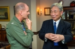 Capt. Greg Fenton, commanding officer of the U.S. Navy's forward-deployed aircraft carrier USS George Washington (CVN 73), left, speaks with Mr. Yoshiyuki Kasai, chairman emeritus, Central Japan Railway Company, during a distinguished visitor embark. U.S. Navy photo by Mass Communication Specialist 3rd Chris Cavagnaro