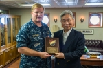 Rear Adm. Mark Montgomery, commander, Battle Force 7th Fleet, left, poses for a photo with Mr. Yoshiyuki Kasai, chairman emeritus, Central Japan Railway Company, during a distinguished visitor embark aboard the U.S. Navy's forward-deployed aircraft carrier USS George Washington (CVN 73). U.S. Navy photo by Mass Communication Specialist 3rd Chris Cavagnaro