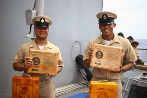 160916-N-RN842-056 (Sept. 16, 2016) Chief Petty Officer Gas Turbine Systems Technician (Electrical) Johnathan F. Burgonio, left, and Chief Petty Officer Gas Turbine Systems Technician (Electrical) Nao K. Mack, right, display commemorative plaques on the occasion of their promotion on board the Ticonderoga-class guided-missile cruiser USS Shiloh (CG 67). Shiloh is on patrol in waters off the coast of Japan, supporting security and stability in the Indo-Asia-Pacific region. (U.S. Navy photo by Gas Turbine Mechanical Technician 3rd Class Xavier B. Phommavong/ Released)